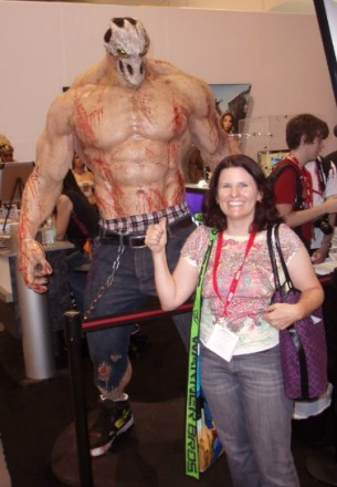 Shirtless, mask-covered monster dude and woman smiling.