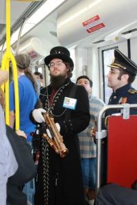 Steampunk man on trolley in San Diego.