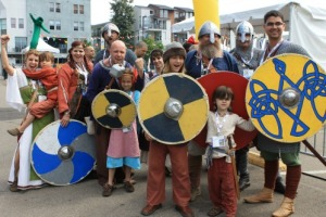 Group of people costumed as Vikings.