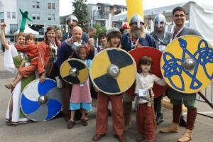 Group of people costumed as Vikings.